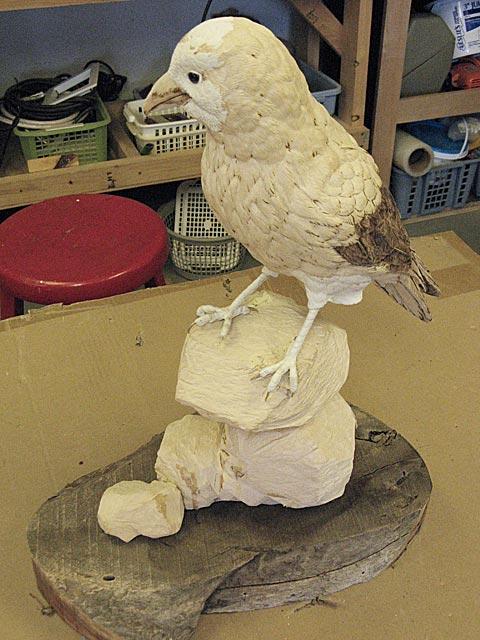 Setting bird on base