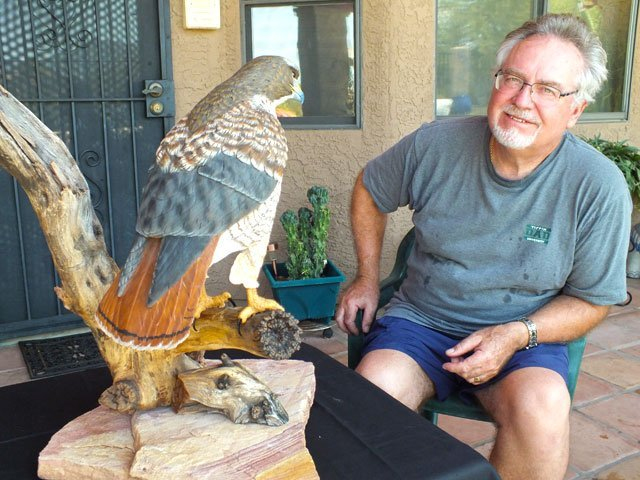 Rob Arnberger with Red Tailed-Hawk carving