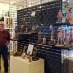 Rob Arnberger with his carvings at the Creative Spirit Artists Gallery in Patagonia, Arizona